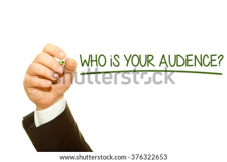 Businessman hand writing Who is your audience? question on a transparent wipe board