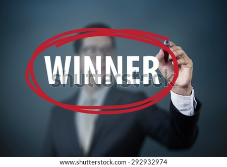"Businessman hand writing ""WINNER"" with red marker on transparent board, new business concept, studio  shot - stock photo"