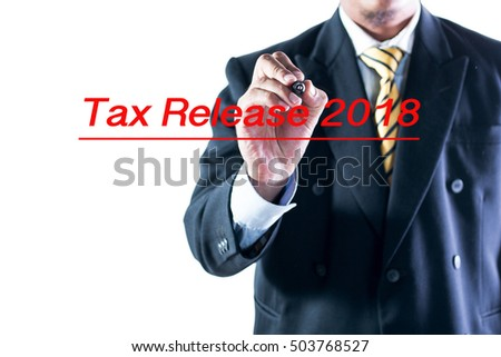 Businessman hand writting Tax Release 2018 on a transparent wipe board.