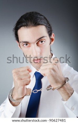 Businessman handcuffed for his crimes - stock photo