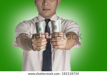 Businessman handing money to you. - stock photo
