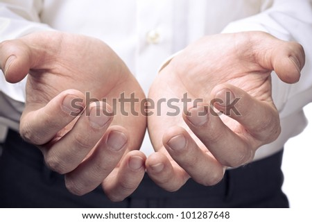 Businessman hands as if holding something. Focus on finger-tips - stock photo