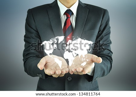 Businessman hands carrying world map  -  rule the world, world domination concepts etc.