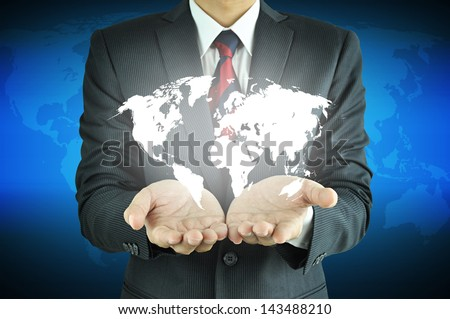 Businessman hands carrying world map  -  rule the world, world domination concepts etc. - stock photo