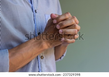 businessman hands clasped praying - stock photo