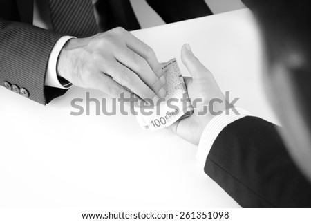 Businessman hands giving & receiving money, Euro currency (EUR), bribery concept - monochrome effect - stock photo