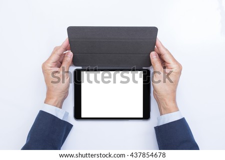 Businessman hands holding blank screen tablet computer - stock photo