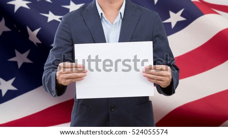 Businessman hands holding blank white board with United State of America flag background