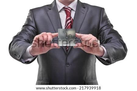 businessman hands holding puzzle Isolated on white background  - stock photo