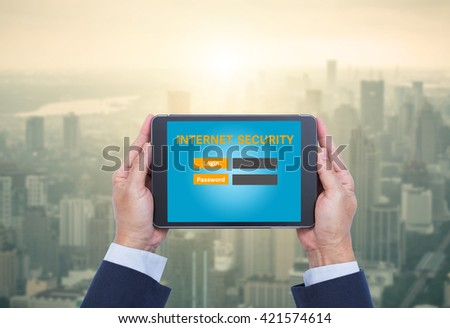 Businessman hands holding tablet computer with internet security login screen with aerial view of cityscape at sunrise background. tablet pc. tablet screen. tablet computer. - stock photo