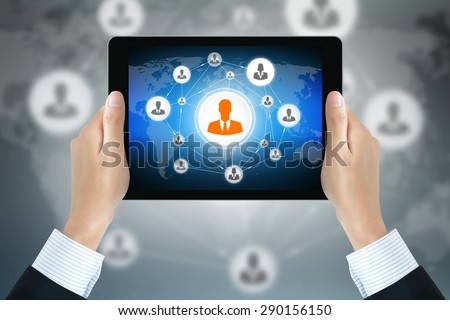Businessman hands holding tablet pc with businesspeople icons linked as network on the screen - business & social network concepts - stock photo