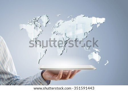 Businessman hands holding tablet with world map on screen