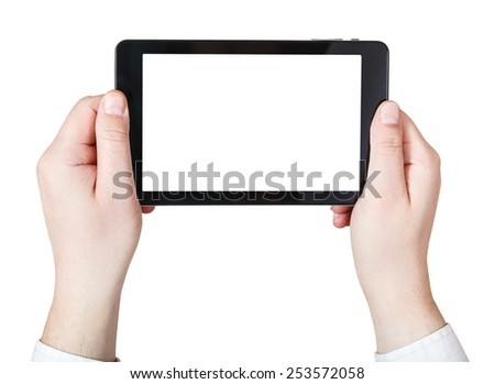 businessman hands holds tablet-pc with cut out screen isolated on white background