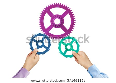 Businessman hands joining cogwheels isolated - stock photo