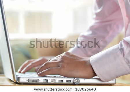 Businessman hands on laptop keyboard typing closeup - stock photo