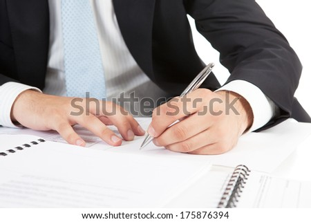 Businessman  hands pointing at business document. Closeup. - stock photo