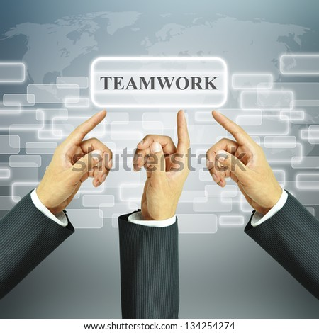 Businessman hands pointing to Teamwork sign - stock photo