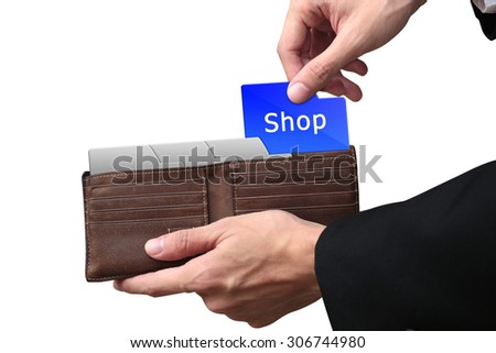 Businessman hands pulling folder Shop concept on brown wallet. - stock photo
