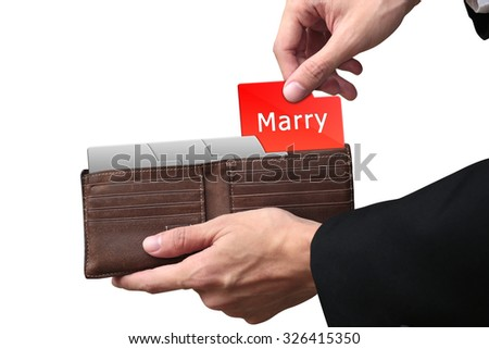 Businessman hands pulling money MARRY concept on brown wallet. - stock photo