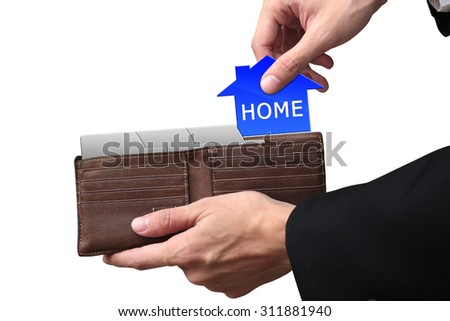 Businessman hands pulling pay HOME concept on brown wallet. - stock photo