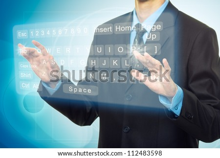 Businessman Hands pushing a button on a touch screen, virtual keyboard - stock photo