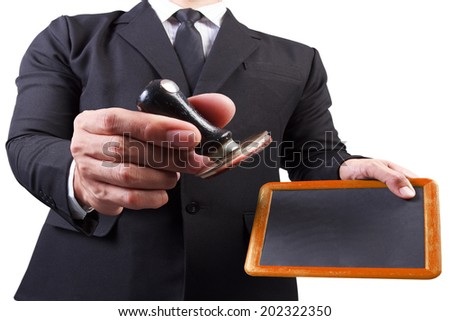 businessman hands put the stamp wood blackboard on white background with clipping path