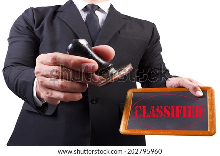businessman hands put the stamp wood blackboard red classified word stamp on white background with clipping path - stock photo