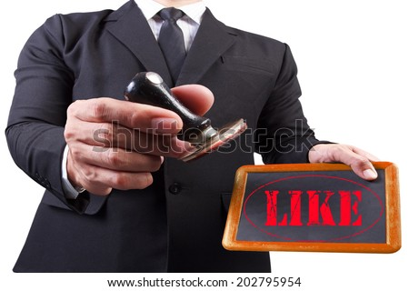 businessman hands put the stamp wood blackboard red like word stamp on white background with clipping path - stock photo