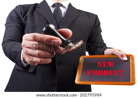 businessman hands put the stamp wood blackboard red new product word stamp on white background with clipping path - stock photo