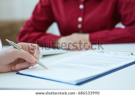 Businessman hands sign contract on desk. Male entrepreneur puts signature on official agreement. Profitable deal concept. Shallow depth of field.