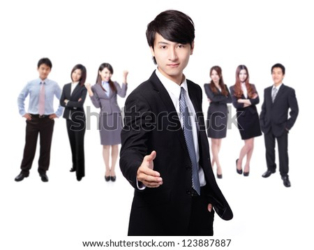 businessman handshake, hold hand welcome gesture, Handsome young business man happy smile shake hand over group of businesspeople background, asian model