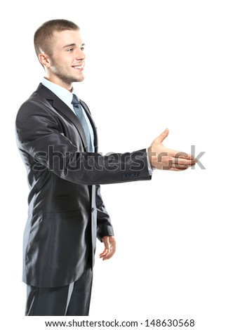 businessman handshake, hold hand welcome gesture, Handsome young excited business man happy smile wear elegant suit and tie isolated over white background - stock photo