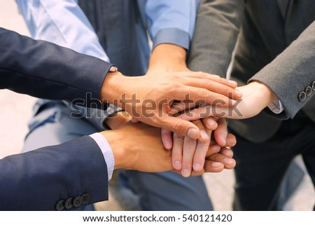 Businessman handshake is showing cooperation. Combination shows success