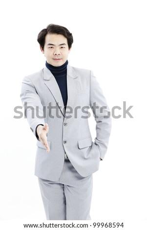 Businessman handshake isolated on white - stock photo