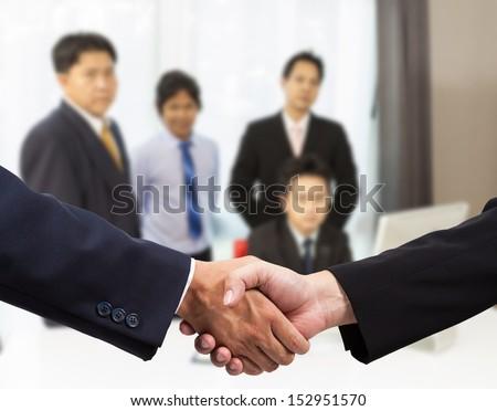 Businessman handshake with colleague - stock photo