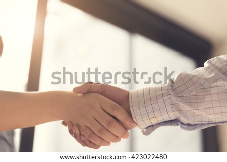 businessman handshaking for business cooperation and acquisition concept, selective focus and vintage tone
