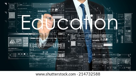 businessman handwriting Education on a transparent board  - stock photo