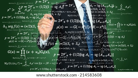 businessman handwriting mathematical operation on a transparent board  - stock photo