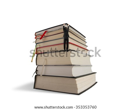 Businessman hanging on top of stack books, isolated on white background.
