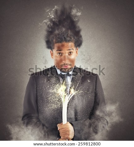 Businessman has an accident and is electrocuted - stock photo
