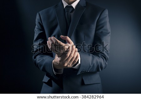 Businessman has hand pain - stock photo