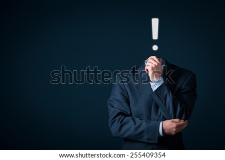 Businessman has idea. An idea is represented by exclamation mark.  - stock photo