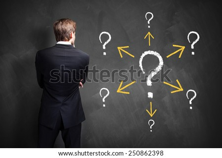 businessman has many follow up questions - stock photo