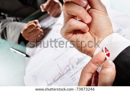 Businessman have an ace under his sleeve while meet his client or partner
