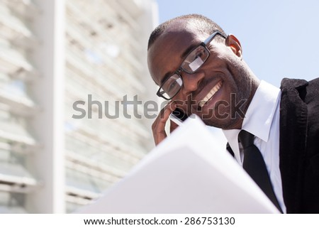 businessman have phone conversation on office building background - stock photo