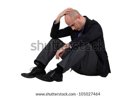 Businessman having a crisis - stock photo