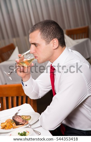 Businessman having a drink at the restaurant.