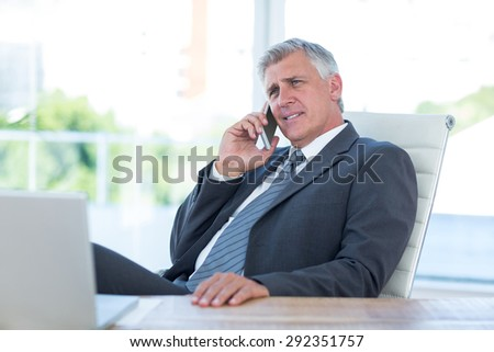 Businessman having a phone call in an office