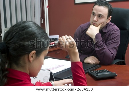 Businessman having a talk with young woman - discussion