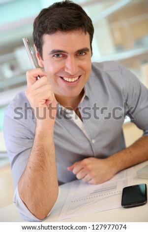 Businessman having a wonderful idea - stock photo